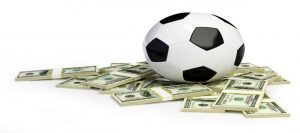 Soccer Ball in a pile of cash