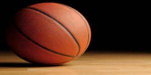 Basketball on a wooden floor.