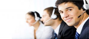 Call center representatives working on a white background.