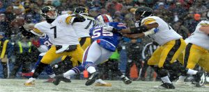 The Buffalo Bills and the Steelers playing while snowing.