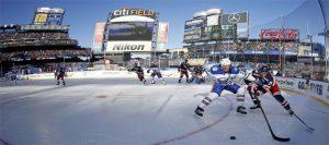 A hockey field with a blue sky