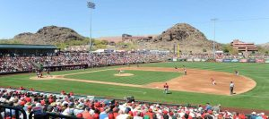 A baseball field with a crowd during a game