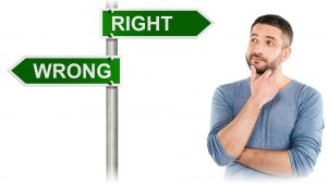 A man contemplating a sign that points to a wrong and a right direction