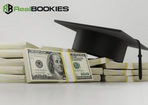 A stack of cash and a college graduation hat with a real bookies logo