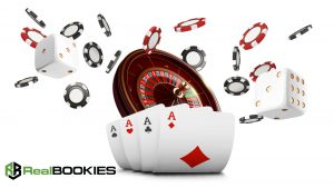 casino chips, dice, roulette and four aces